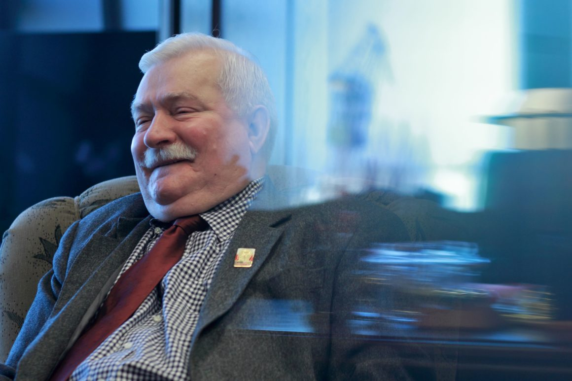 TOPSHOT - Lech Walesa, former president of Poland, wearing a pin of the Black Madonna of Czestochowa on his lapel, reacts on January 04, 2016, during an interview in his office in Gdañsk, Poland. Lech Wa??sa, born 29 September 1943, is a Polish politician, trade union organizer, philanthropist and human rights activist. A charismatic leader, he co-founded Solidarity (Solidarno??), the Soviet bloc's first independent trade union, won the Nobel Peace Prize in 1983, and served as President of Poland from 1990 to 1995. Behind Walesa, a mirror image of Gdansk'shipyards. / AFP / PIOTR WITTMAN (Photo credit should read PIOTR WITTMAN/AFP/Getty Images)