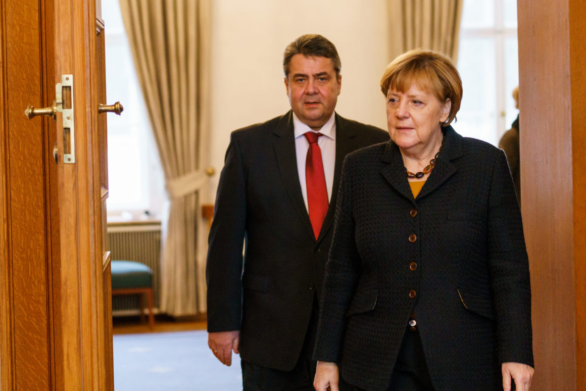 BERLIN, GERMANY - JANUARY 11: German Chancellor Angela Merkel and German Vice-Chancellor Sigmar Gabriel arrive to write a message in the book of condolence for the family of Former German President Roman Herzog at Bellevue Palacee on January 11, 2017 in Berlin, Germany. Former German President Roman Herzog, who served in from 1994 until 1999, died yesterday at the age of 82. (Photo by Jochen Zick - Pool/Getty Images)