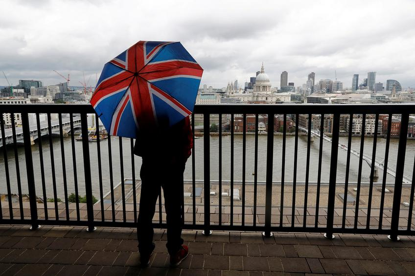 A man holding an umbrella poses at a new viewing platform during the unveiling of the New Tate Modern in London, Britain, June 14, 2016.    REUTERS/Stefan Wermuth/File Photo