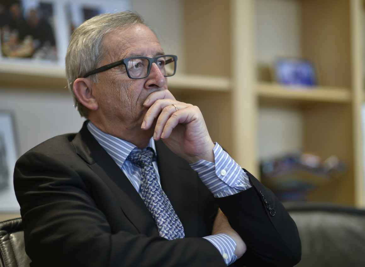 TO GO WITH AFP STORY BY CHRISTIAN SPILLMANN European Commission President Jean-Claude Juncker answers questions during an interview with AFP on August 4, 2015 in Brussels. EU governments have a duty to help the flood of migrants arriving in Europe and must not cave in to populist demands to turn them back, European Commission chief Jean-Claude Juncker said on August 5. AFP PHOTO / JOHN THYS (Photo credit should read JOHN THYS/AFP/Getty Images)