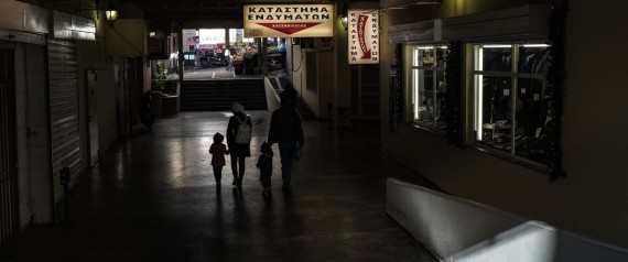A family walks through an arcade, in the Varvakios Market, in Athens, on December 12, 2016 / ??? ?????????? ????????? ??? ????, ???? ????????? ?????, ???? ?????, ???? 12 ??????????, 2016