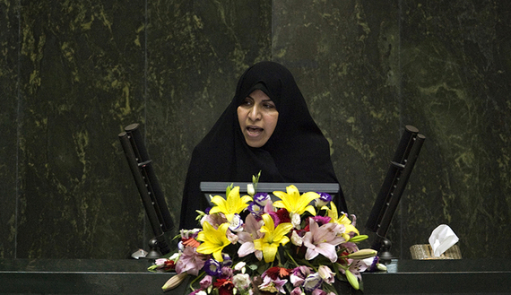 EDITORS' NOTE: Reuters and other foreign media are subject to Iranian restrictions on their ability to film or take pictures in Tehran. Nominee for Health Minister Marzieh Vahid-Dastjerdi speaks to lawmakers in parliament in Tehran September 1, 2009. REUTERS/Morteza Nikoubazl (IRAN POLITICS) - RTR27BK4
