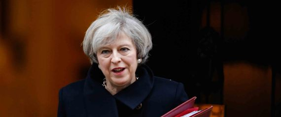 Theresa May, U.K. prime minister, carries a document folder as she leaves 10 Downing Street to attend the weekly question-and-answer session in parliament, in London, U.K., on Wednesday, Feb. 8, 2017. Sterling has climbed more than 4 percent since May laid out the U.K.'s plan for Brexit last month. Photographer: Luke MacGregor/Bloomberg via Getty Images