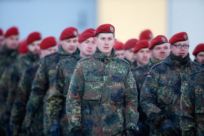 """OBERVIECHTACH, GERMANY - JANUARY 19: Soldiers of armored infantry battalion Panzergrenadierbataillon 122 of the Bundeswehr, the German armed forces, attend a ceremony to mark their pending deployment to Lithuania on January 19, 2017 in Oberviechtach, Germany. A total of 450 soldiers from the unit as well as armored equipment that includes Marder light tanks will begin deploying at the end of January as part of the NATO mission """"Enhanced Forward Presence"""" to strengthen the defensive capabilities of the three Baltic states. (Photo by Johannes Simon/Getty Images)"""