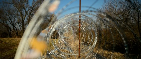 """A barbed wire fence is set up along the Slovenian-Croatian border in Rakovec, in Slovenia, on February 16, 2017. Slovenia on January 26, 2017 approved a bill allowing police to seal the border with Croatia to migrants in case of a new influx along the so-called Balkan route, sparking condemnation from rights groups. Under the new legislation, Slovenian authorities can reject asylum seekers directly at the frontier with non-Schengen member Croatia if migrant numbers suddenly rise and """"threaten public order and internal security"""".  / AFP / Jure MAKOVEC        (Photo credit should read JURE MAKOVEC/AFP/Getty Images)"""