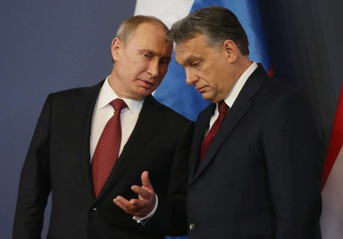 BUDAPEST, HUNGARY - FEBRUARY 17: Russian President Vladimir Putin (L) and Hungarian Prime Minister Viktor Orban converse during a signing ceremony of several agreements between the two countries at Parliament on February 17, 2015 in Budapest, Hungary. Putin is in Budapest on a one-day visit, his first visit to an EU-member country since he attended ceremonies marking the 70th anniversary of the D-Day invasions in France in June, 2014. (Photo by Sean Gallup/Getty Images)