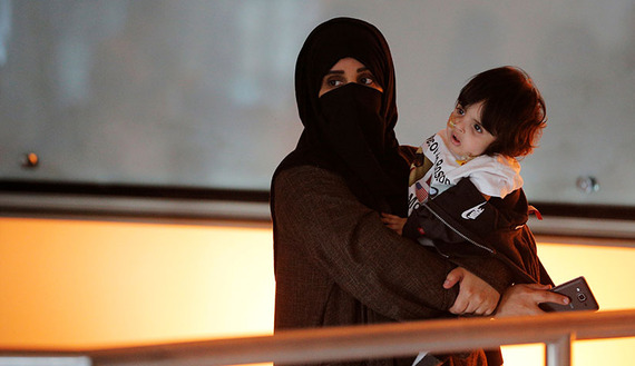 A woman and her daughter wait for two of her other children and her sister to arrive on a flight from Qatar after U.S. President Donald Trump's executive order travel ban at Logan Airport in Boston, Massachusetts, U.S. January 30, 2017. REUTERS/Brian Snyder - RTX2YWWV