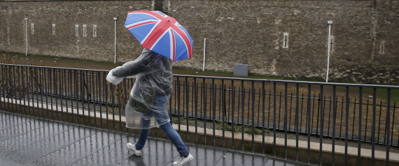 """A tourist carrying a Union Flag umbrella walks in the rain during a spell of wet weather, next to The Tower of London, in London, Britain January 15, 2017. Britain's Prime Minister Theresa May will call on Britons to reject the acrimony of the Brexit referendum in a speech this week that some newspapers have billed as setting the stage for a """"hard"""" exit from the European Union.Investors will scrutinise May's speech on Tuesday for clues on whether she plans to prioritise immigration controls and bilateral trade deals in a """"hard Brexit"""" that would see Britain leave the EU's single market and customs union.  REUTERS/Peter Nicholls"""