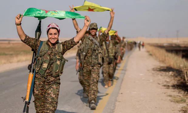 Kurdish REUTERS fighters in northern Syria fly the flag 1a