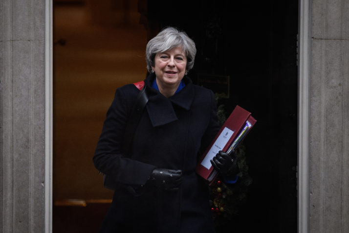 LONDON, ENGLAND - DECEMBER 20: British Prime Minister Theresa May leaves number 10, Downing Street as she heads to the House of Commons for the weekly Prime Minister's Questions session on December 20, 2017 in London, England. (Photo by Leon Neal/Getty Images)