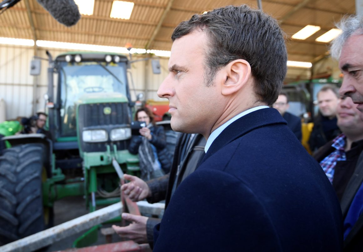 French presidential election candidate for the En Marche ! movement Emmanuel Macron looks on in a farm in Usseau near Poitiers, central France, on April 29, 2017 while campaigning ahead of the second and final round of the presidential elections which takes place on May 7. / AFP PHOTO / POOL / Eric FEFERBERG (Photo credit should read ERIC FEFERBERG/AFP/Getty Images)
