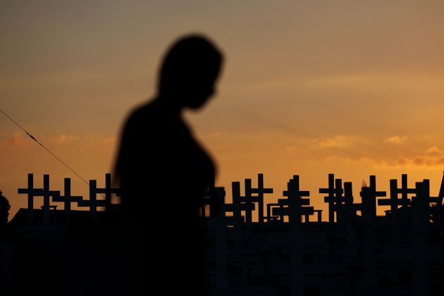 A woman walks past the graves of soldiers killed in the 1974 Turkish invasion of Cyprus at the Tymvos Macedonitissas military cemetery in Nicosia, on July 16,2014, as the nation prepares to mark the 40th anniversary of the invasion of the northern third of the east Mediterranean island of Cyprus following an Athens-backed coup. AFP PHOTO/YIANNIS KOURTOGLOU (Photo credit should read Yiannis Kourtoglou/AFP/Getty Images)