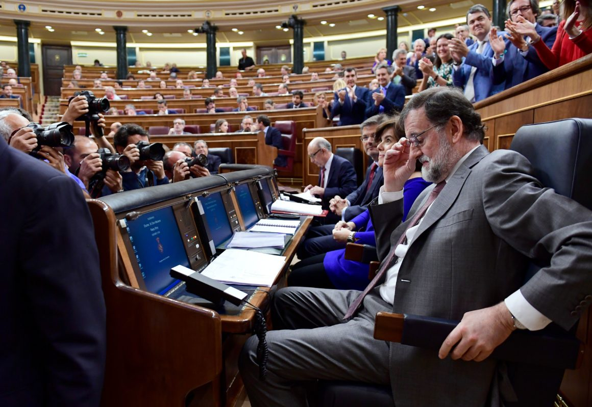 Spanish Prime Minister Mariano Rajoy attends a session at the Lower House of Parliament in Madrid on May 30, 2018, two days before the assembly will debate a no-confidence motion against his government. - The Socialists filed the motion seeking Rajoy's ouster in parliament, a day after a court fined his Popular Party for benefiting from illegal funds in a massive graft trial. Spain's National Court said it had uncovered a vast system of bribes given to former PP officials in exchange for lucrative public contracts between 1999 and 2005. (Photo by PIERRE-PHILIPPE MARCOU / AFP) (Photo credit should read PIERRE-PHILIPPE MARCOU/AFP/Getty Images)