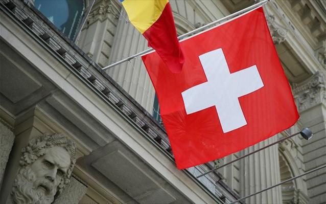 Swis flag 1a Reuters Denis Balibouse
