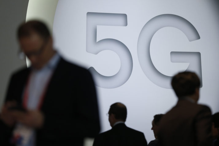 People walk by a 5G stand at the Mobile World Congress (MWC), the world's biggest mobile fair, on February 26, 2018 in Barcelona. the Mobile World Congress is held in Barcelona from February 26 to March 1. / AFP PHOTO / Pau Barrena (Photo credit should read PAU BARRENA/AFP/Getty Images)