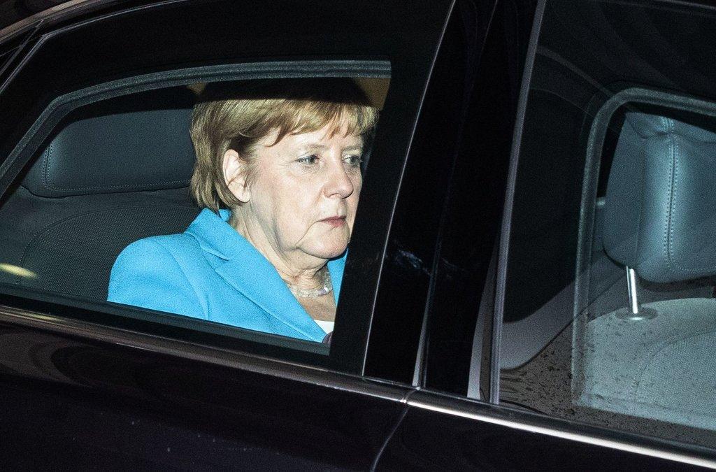 Merkel sad in car 1a Omer Messinger Agence France Presse Getty Images