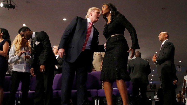 Republican presidential nominee Donald Trump and Omarosa Manigault attend a church service, in Detroit, Michigan, U.S., September 3, 2016. REUTERS/Carlo Allegri - S1AETZFCTSAA