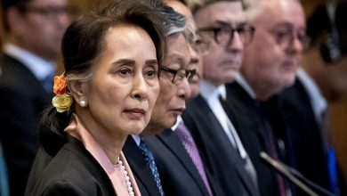 Photo of Aung San Suu Kyi impassive as genocide hearing begins