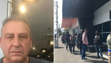 Photo of Greek Australian Samaritan hands out $100 to each person at Centrelink