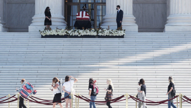 Photo of Hundreds pay respect to Ruth Bader Ginsburg as her flag-draped casket arrives at Supreme Court