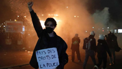 Photo of Protests in Paris turn violent in wake of footage showing police bashing black music producer Michel Zecler